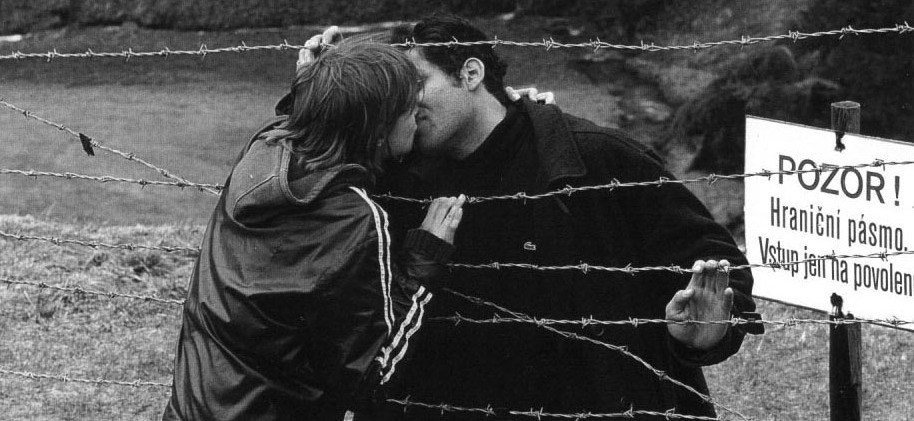 Kiss through barbed wire.